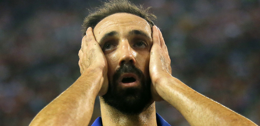 Atletico Madrid's Juanfran reacts after failing to score against Celta Vigo during their Spanish first division soccer match at Vicente Calderon stadium in Madrid