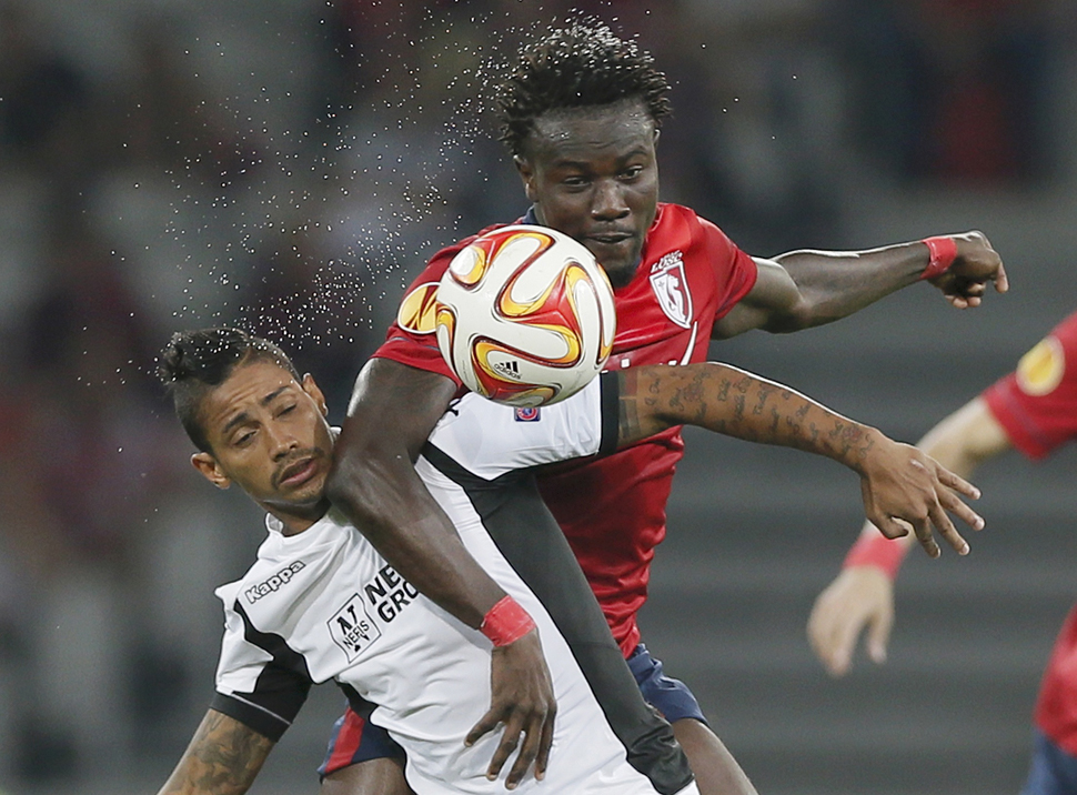 Lille's Souare challenges Krasnodar's Laborde during their Europa League soccer match at the Pierre Mauroy Stadium in Villeneuve d'Ascq