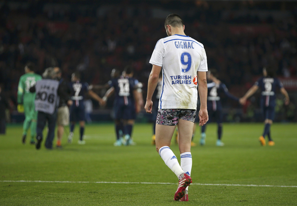 Olympique Marseille's Gignac walks on the pitch after giving his pants to supporters at the end of their French Ligue 1 soccer match against Paris St Germain's at the Parc des Princes stadium in Paris