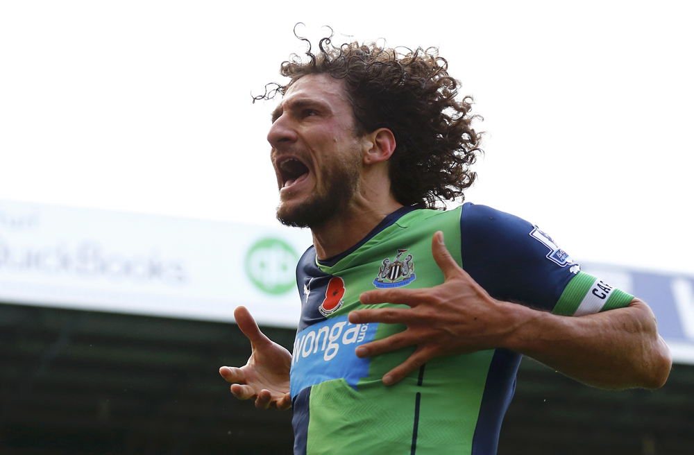 Newcastle United's Fabricio Coloccini celebrates after scoring during their English Premier League soccer match against West Bromwich Albion at The Hawthorns in West Bromwich
