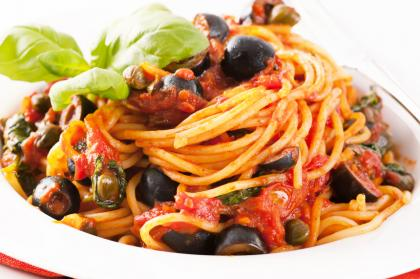 Black Olives With Tomatoes And Capers Over Pasta