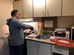 Bringing pizza and having dinner with residents
