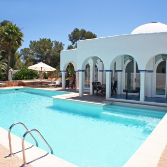 The pool area at Can Punta, a luxury villa to rent in Ibiza