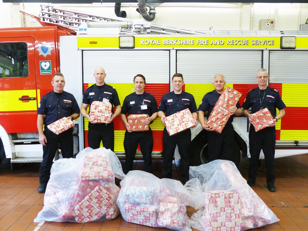 reading firefighters deliver christmas gifts to kids in hospital