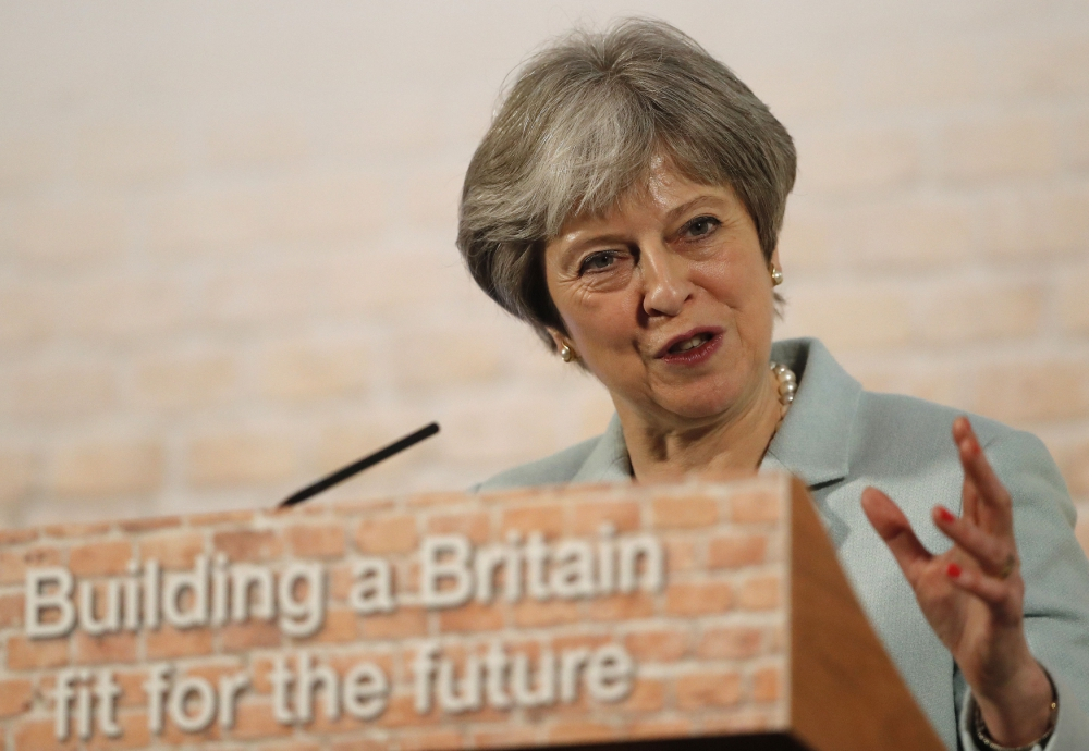 Britain's May calls on housebuilders to