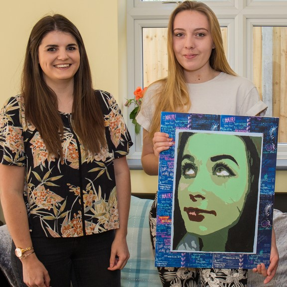 Caitlin-a-resident-at-Reading-Road-proudly-showcases-artwork-with-support-worker-Katie
