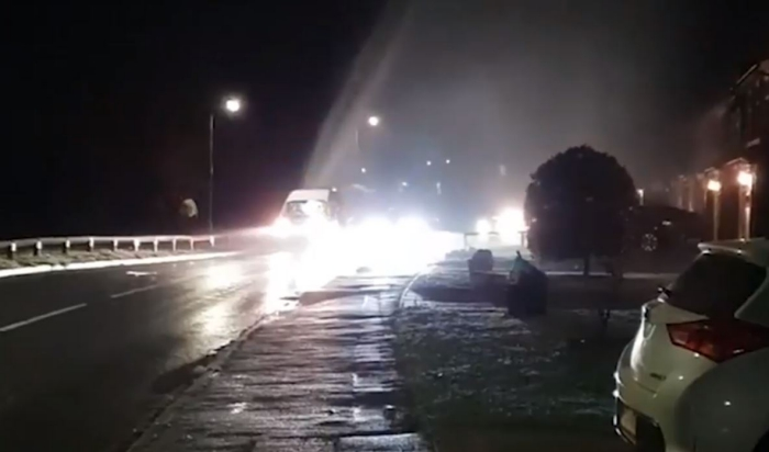 Huge jet of water captured spurting into the air in Woodley