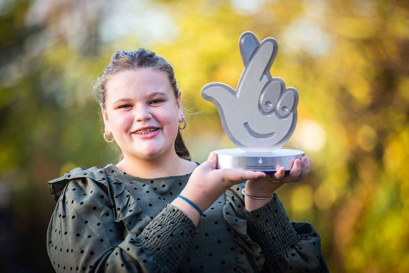National Lottery Young Hero Shows the Spirit of Knock and Check.