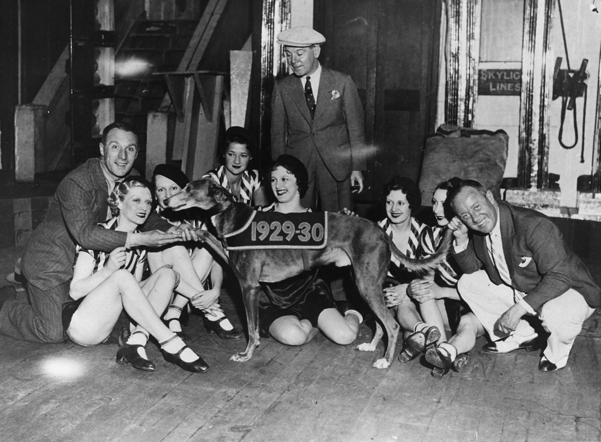 The Crazy Gang members with showgirls from the London Palladium with greyhound Mick the Miller 1934                      (Image: Media Wales