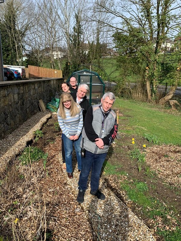 Companions from Emmaus South Wales enjoying gardening