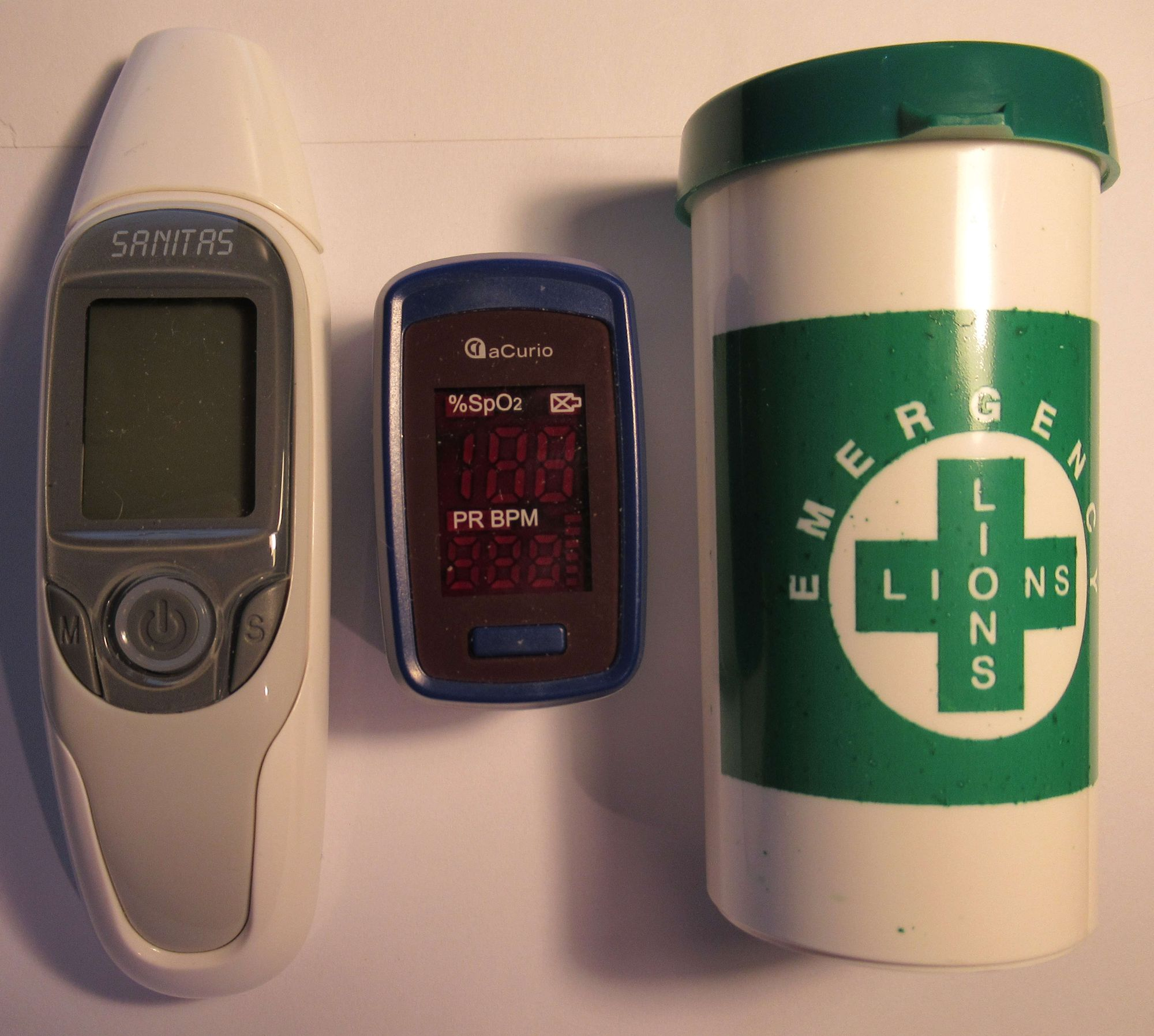 The in-ear thermometer, pulse oximeter and the free Lions plastic bottle with our medical history and