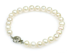 Katie - single strand A+ pearl bracelet with pique a jour clasp, lovely birthday or graduation gift