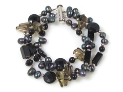 Miss coco - luxurious treble strand oval black pearls and gemstone bracelet