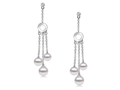 Diana Dors - Luxurious dangling pearl earrings with three perfectly round pearls on white gold finish long chain base