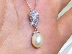 Julieta - Elegant oval pearl pendant by Jacqueline Shaw London