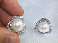 Lady Saturn large freshwater pearl ear studs by Jacqueline Shaw London