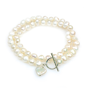 Amor - large baroque pearl single strand pearl necklace with a heart shaped coin pearl pendant