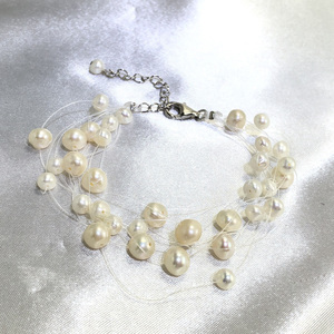 Snow Gypsophila - luxury 8 strand floating pearl bracelet