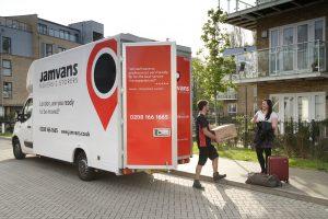Removal men unloading belongings from a JamVans van
