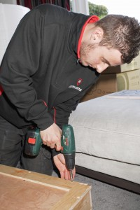 Man drilling furniture