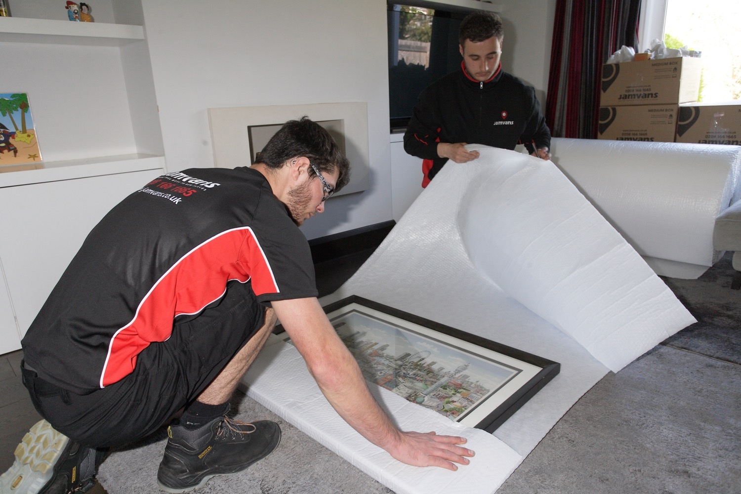 Removals man wrapping up a picture