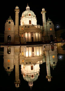 Karlskirche reflected in the fountain by night