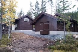 Hytta og båthuset - Foto: