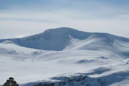 Kråkvasstind i vinterdrakt -  Foto: Bente Vasli