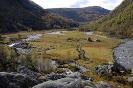 På sletta lå den gamle fjellgarden Kvitlen - Foto: Odd Inge Worsøe