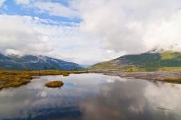 Det er små idylliske tjønner oppe på toppen - Foto: Kjell Fredriksen