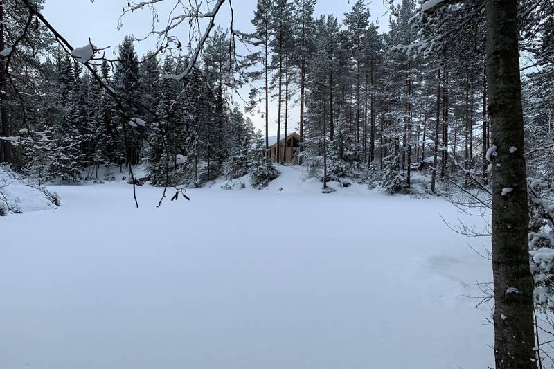 Huldreheim sett fra Ramstadsjøen, i byggeperioden.