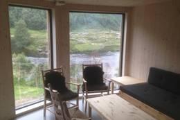 Kvitlen avdelingen mot elva har egen stue for dem som vil nyte utsikten og roen fra hovedstua - Foto: Per Henriksen