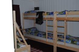Stort soverom med 7 sengeplasser - Foto: Ukjent