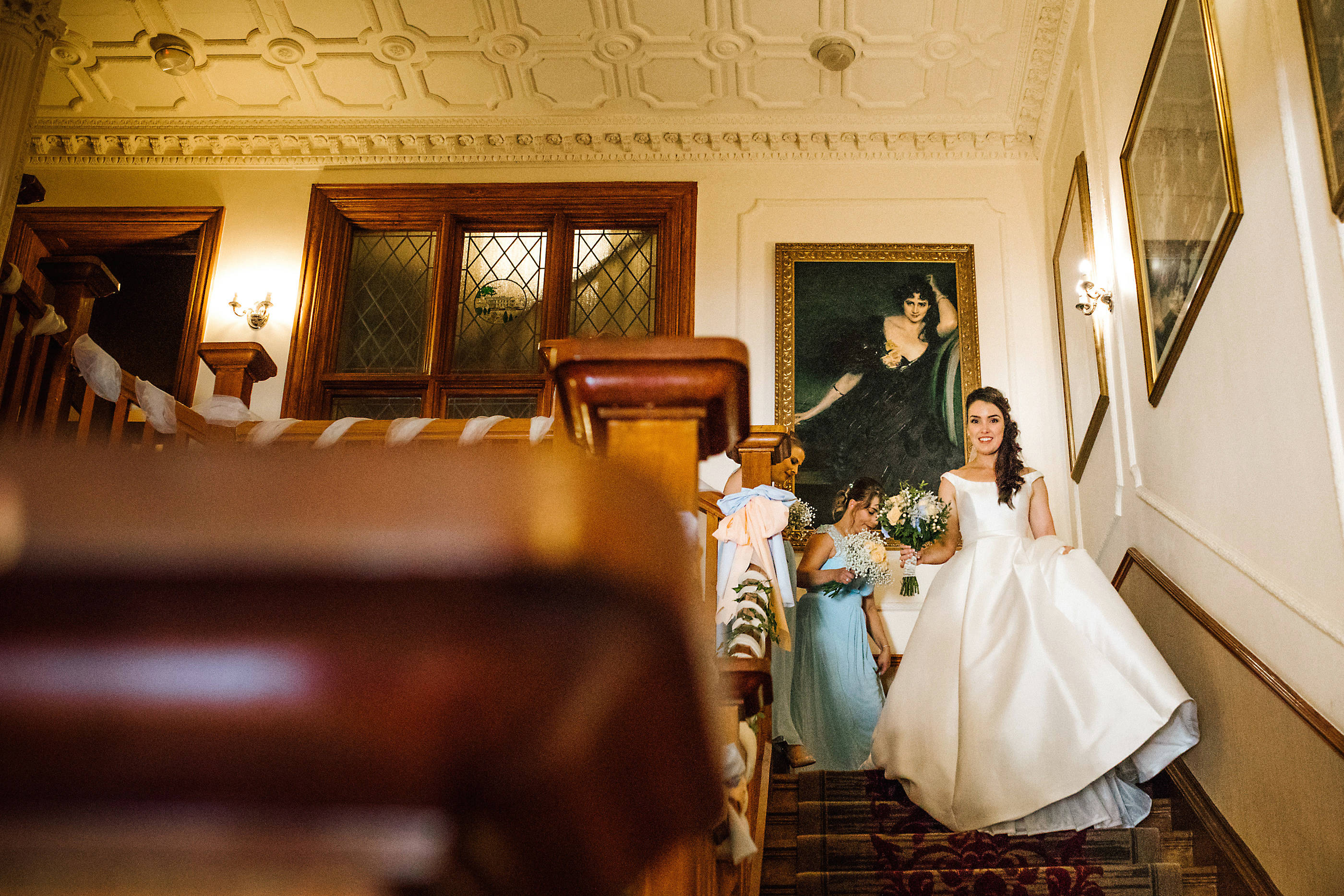 bride coming down stairs at nunsmere hall
