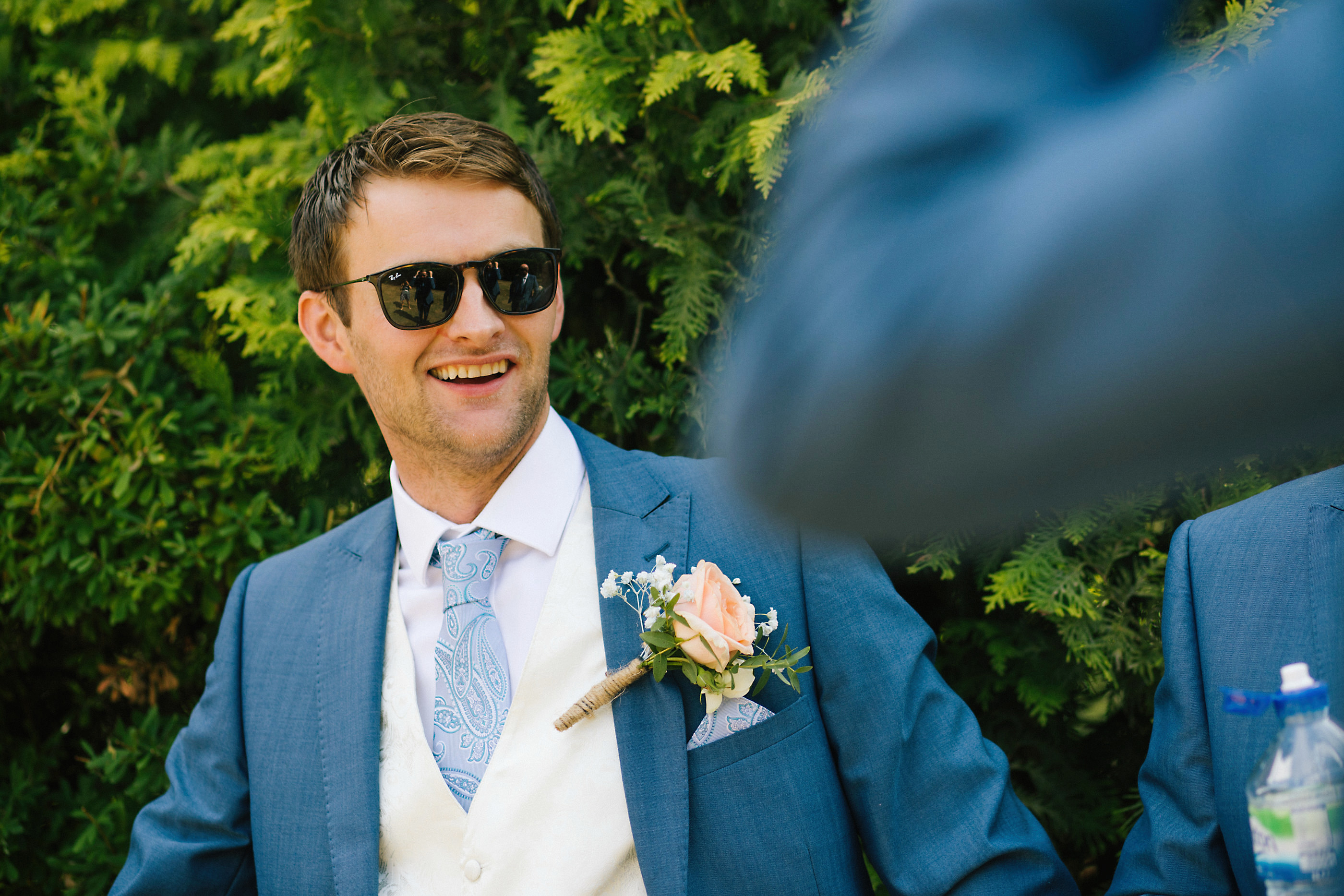 groom wearing sunglasses