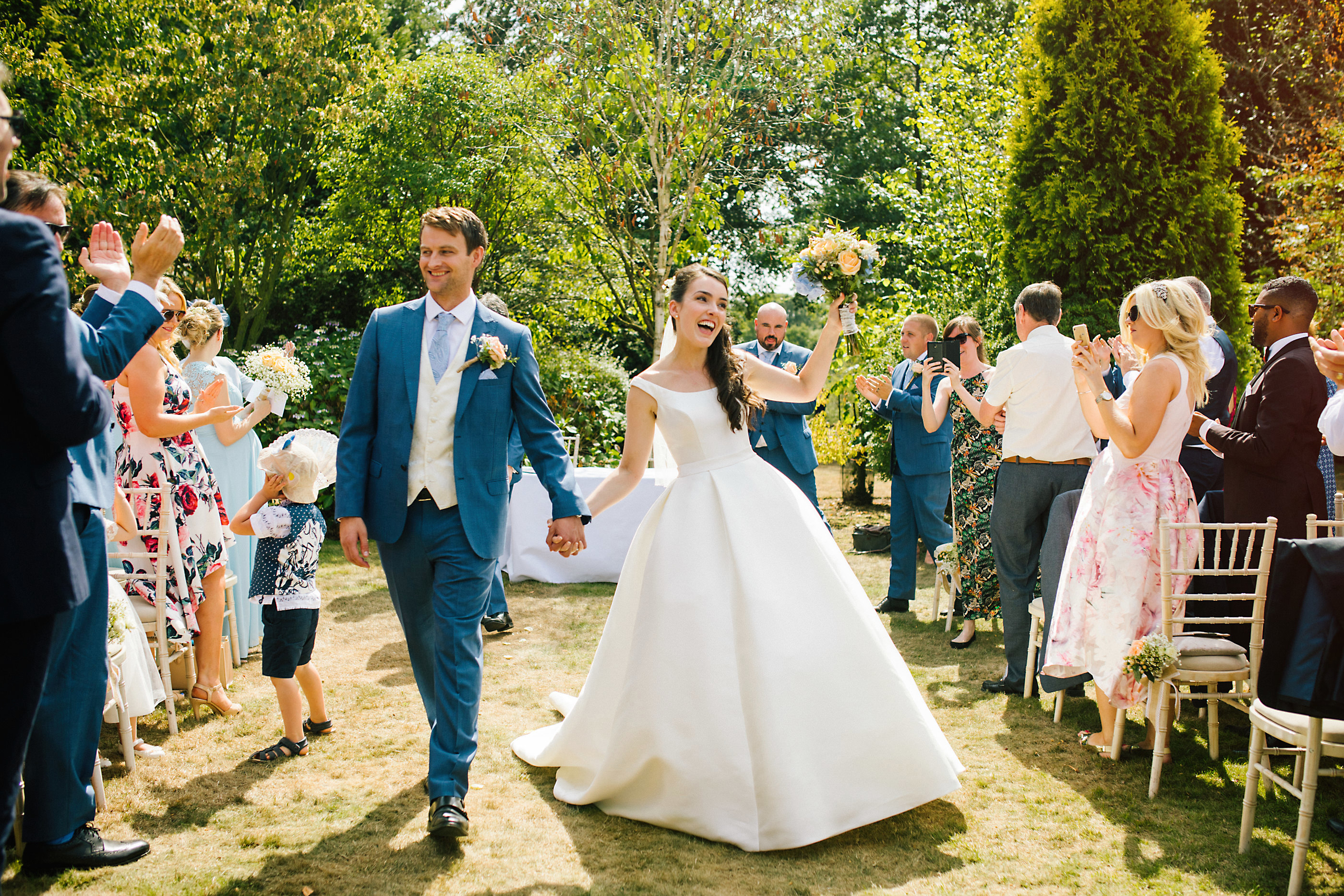 bride and groom walking down the aisle at nunsmere