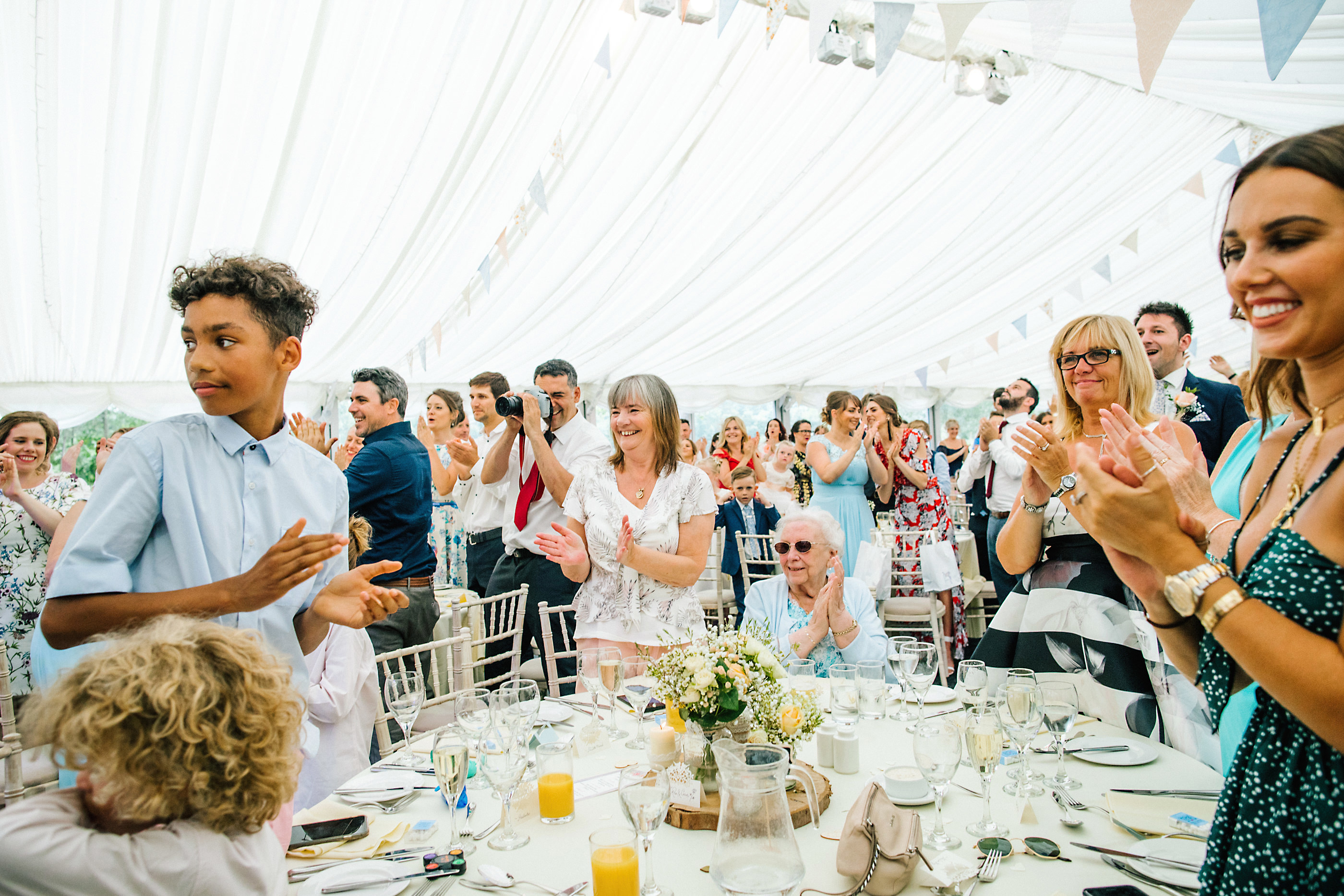 guests clapping at wedding