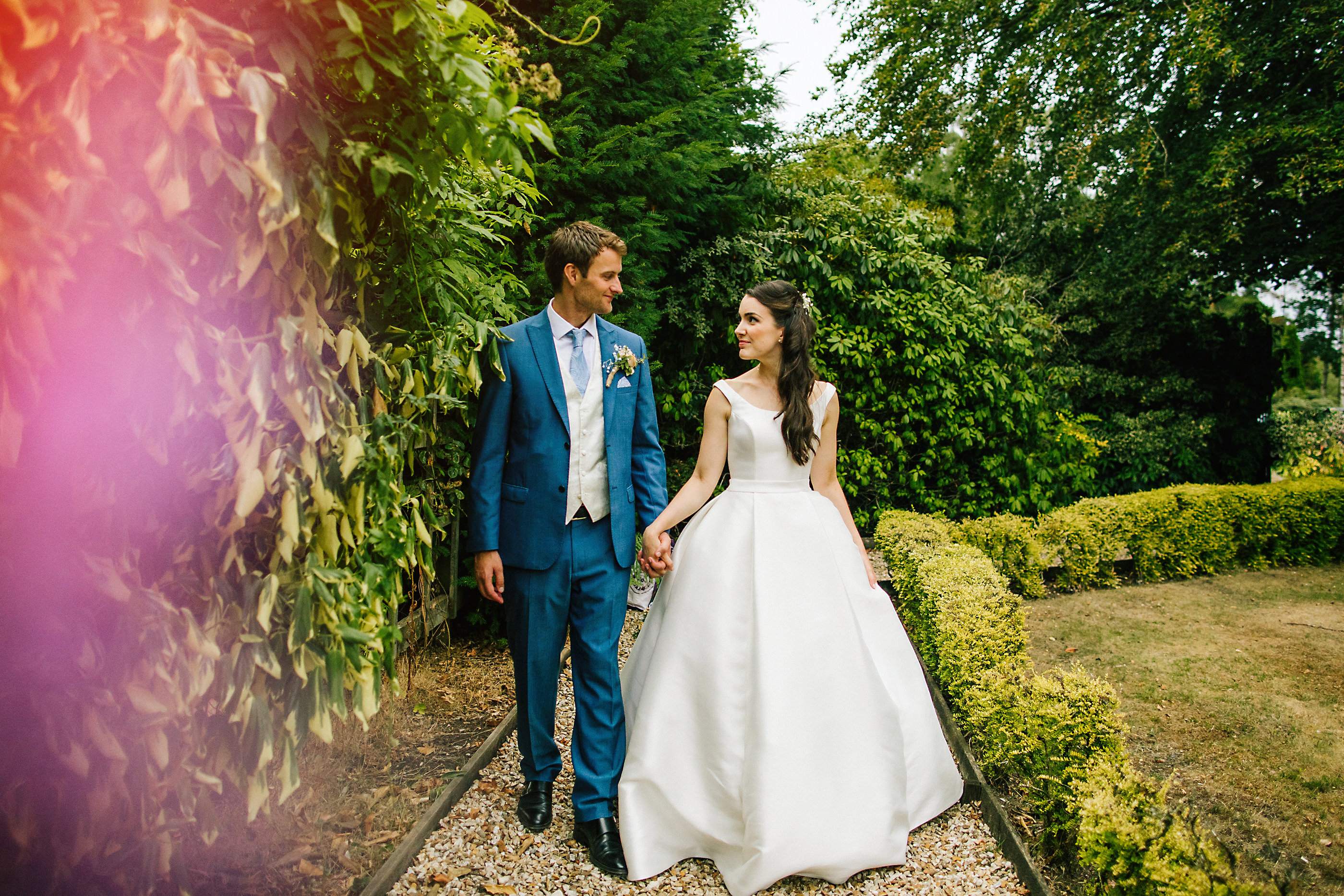 bride and groom in nunsmere gardens