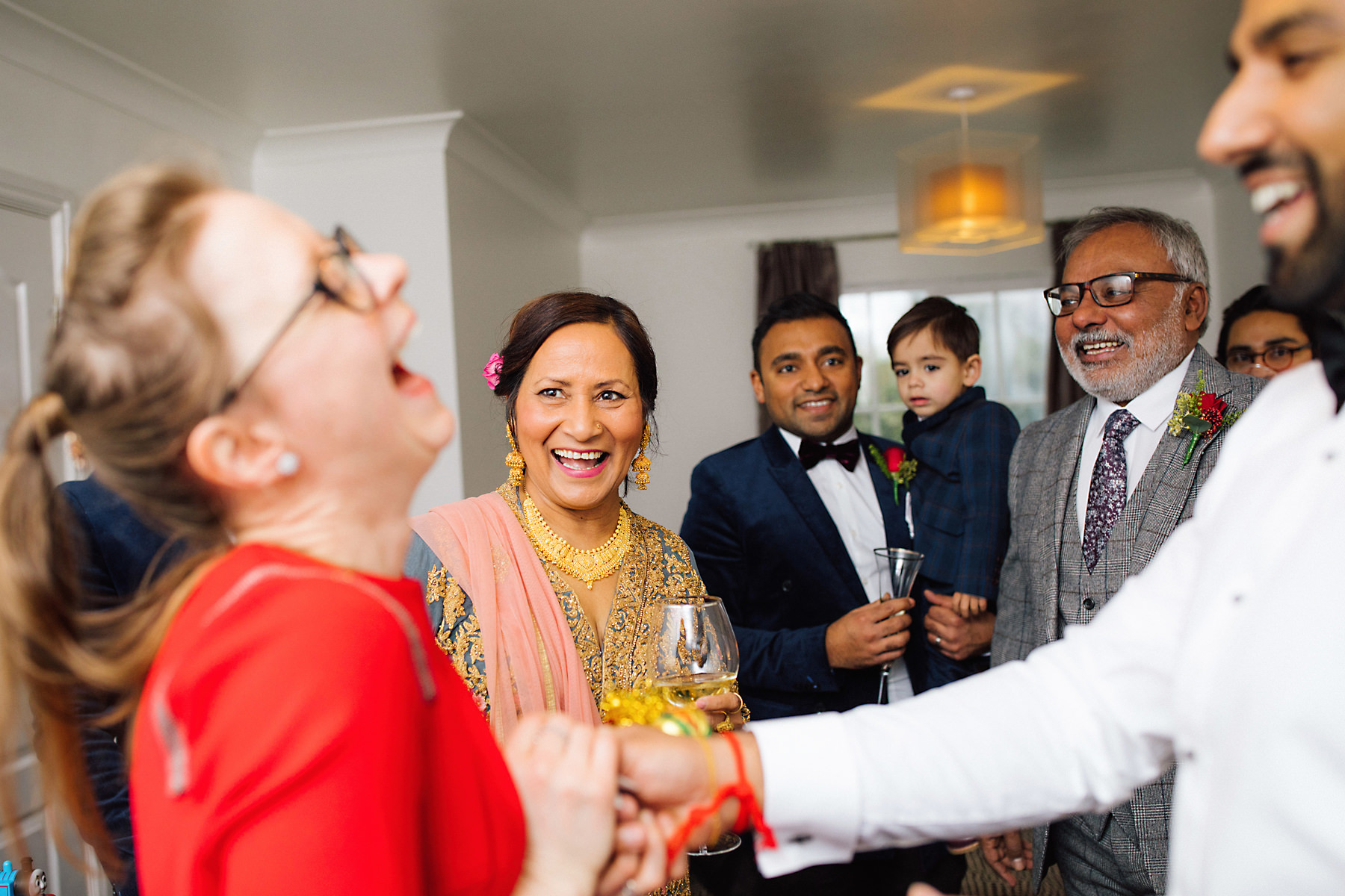 guests laughing at wedding