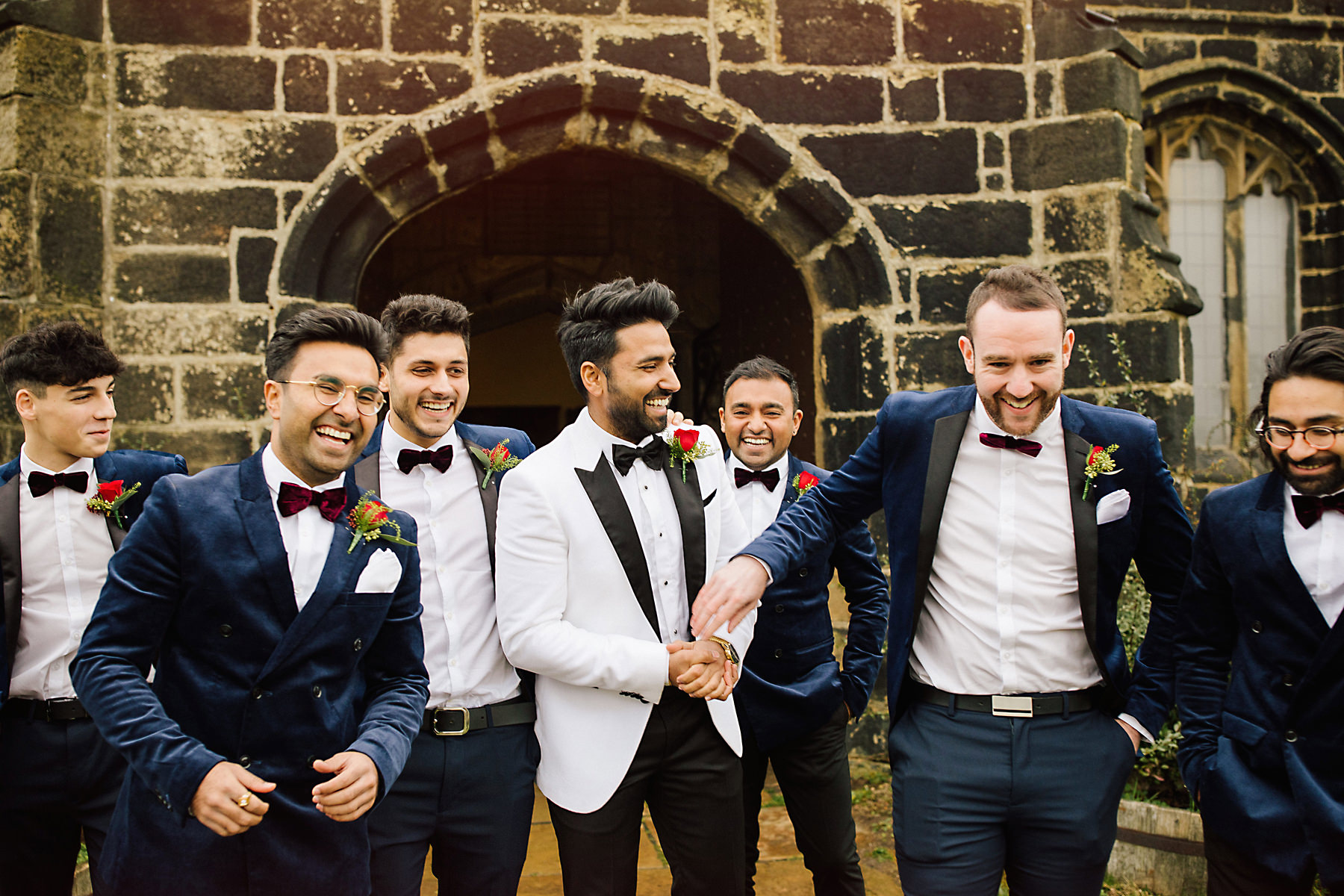 groomsmen outside church before ceremony