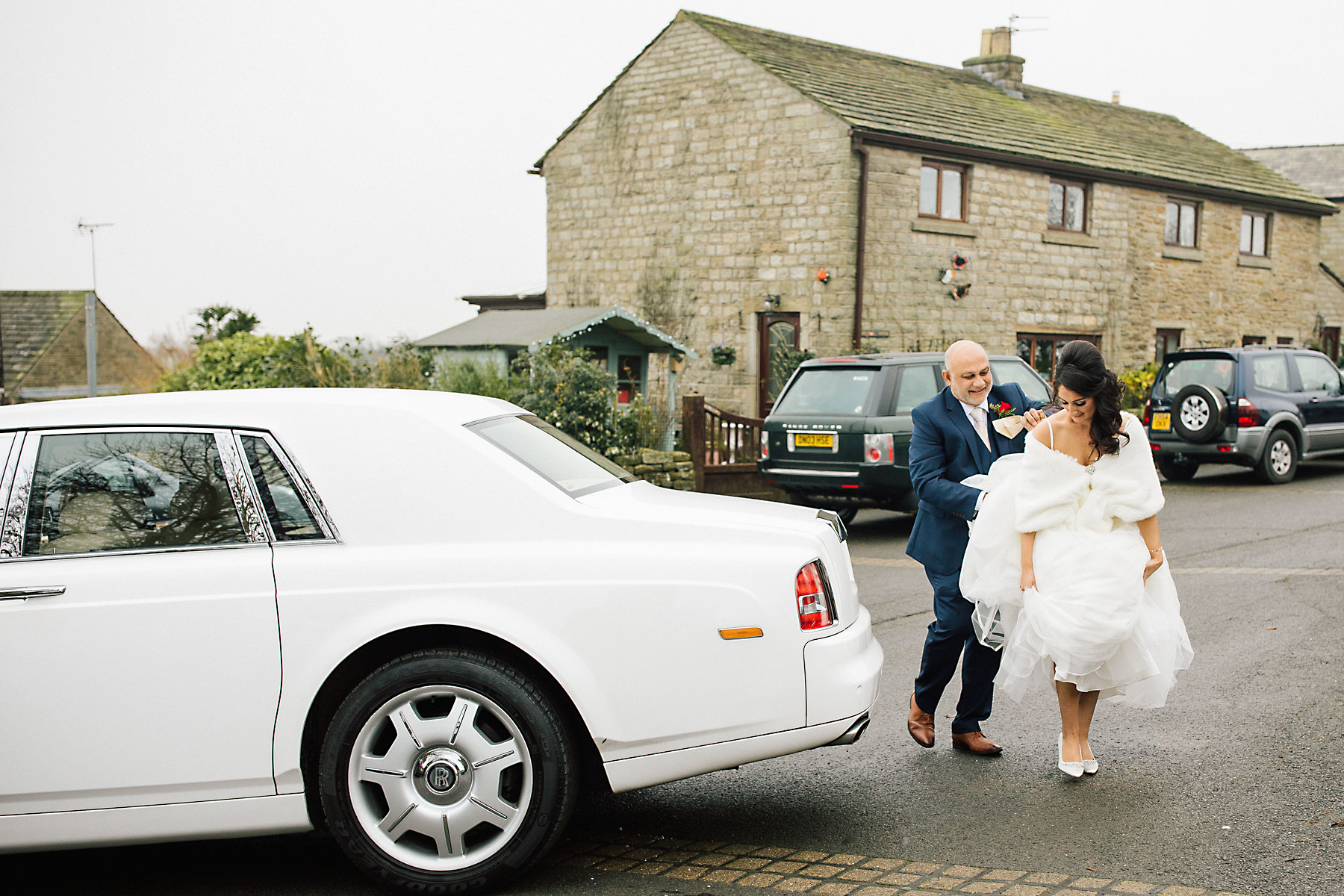 white rolls royce wedding car