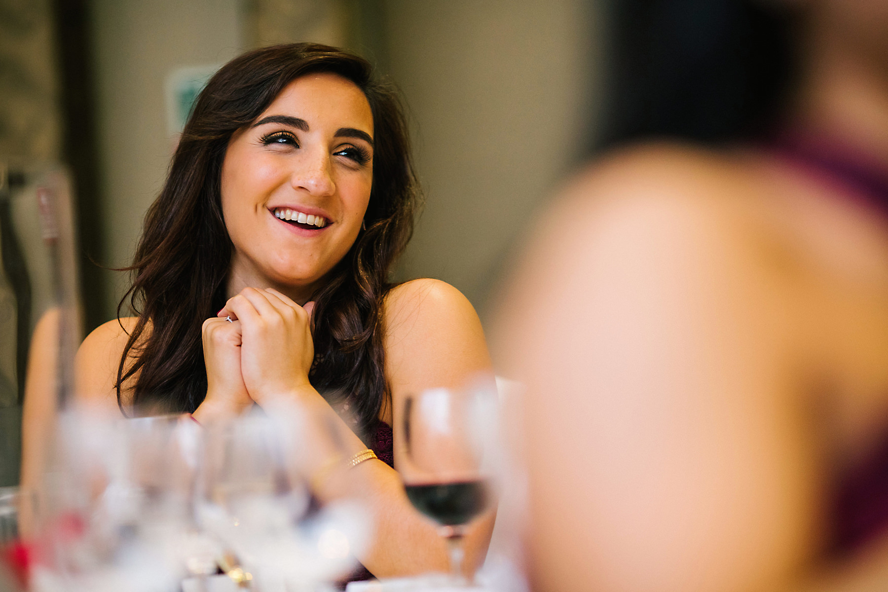 bridesmaid laughing at speeches