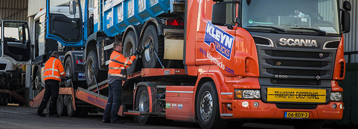 kleyn employees preparing trucks for road transport