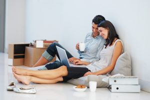 Beautiful business couple working on laptop at home