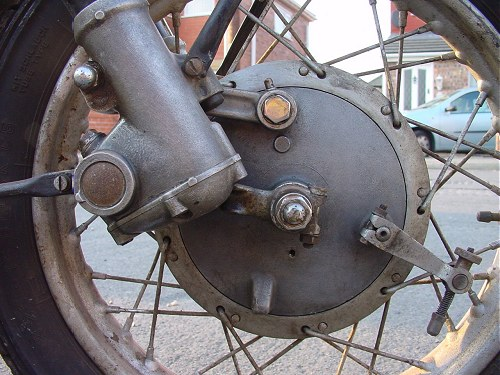 Parallelogram linkage conects front wheel to suspension units.