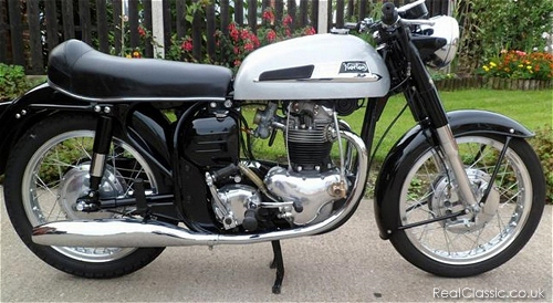 Don't stand too close when photographing your bike; it'll end up looking curved like this Norton...