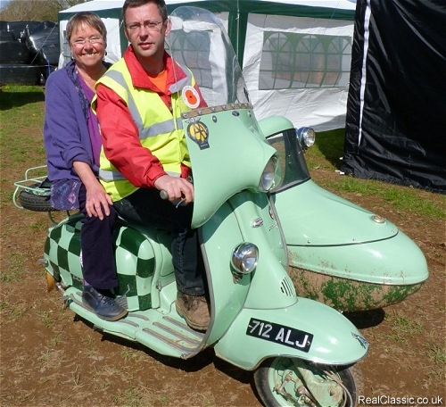 Dr Sheila Cassidy being taken for a tour of the site on a 1960 Lambretta combination...