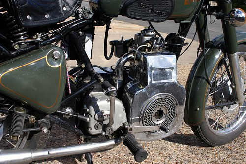 Fan cooling is a remnant of the bike's building-site origins.