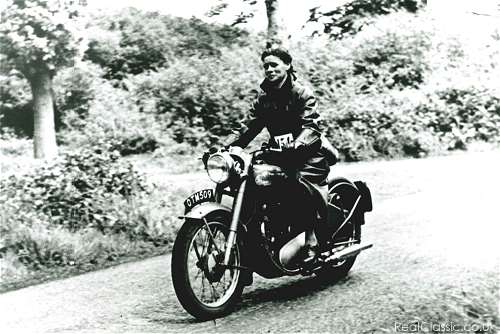 'With hair drawn back (never covered), waterproof coat, skirt, stout shoes and shoulder bag, she travelled everywhere by motorcycle'
