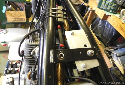the coil and ignition unit installed on the frame...